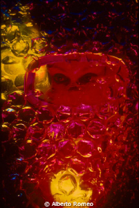 Plastic bubbles, eyes and colored light.